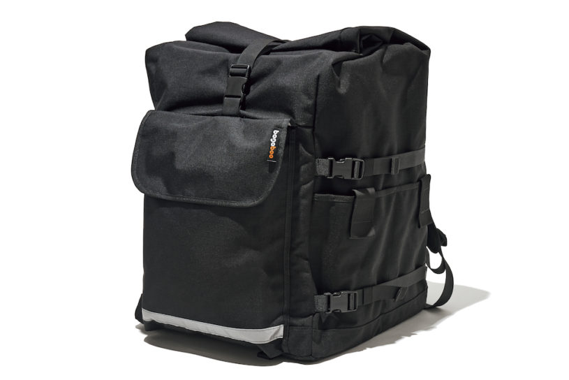Super sized yet functional. A unique delivery backpack with a messenger bags perspective.